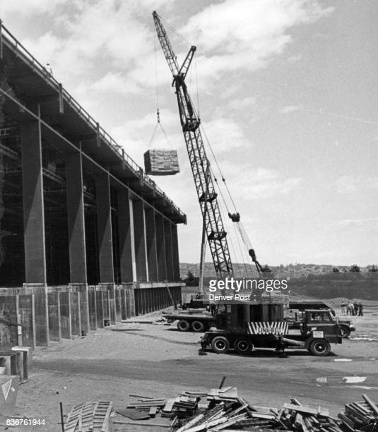 Air Force Academy Buildings Crane lifts roofing material to the top of the $58 million field house The in door athletic complex will have a 2600seat...