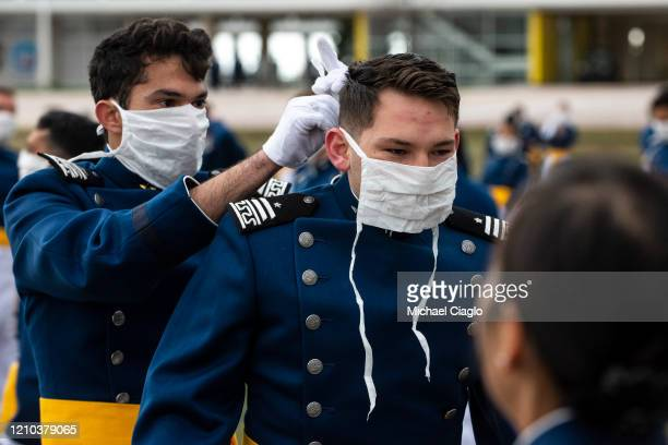 Air Force Academy cadets help each other put on masks after their graduation ceremony on April 18 2020 in Colorado Springs Colorado Saturday's...