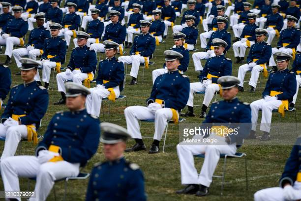 Air Force Academy cadets spaced eight feet apart listen to a commencement address during their graduation ceremony on April 18 2020 in Colorado...