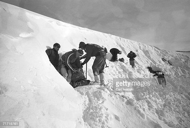 Air Force Academy cadets stand in the entrances to their manmade snow caves as they buckle their packs and prepare to depart near Loveland Pass...