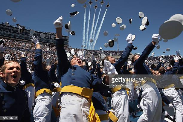 Air Force Academy graduates celebrate as a team of F16 Thunderbirds flies over during the US Air Force Academy graduation ceremony at Falcon Stadium...