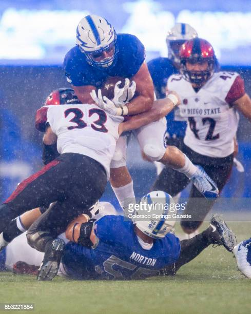 US Air Force Academy running back Parker Wilson is tackled San Diego State University safety Parker Baldwin on Saturday Sept 23 2017 at Falcon...