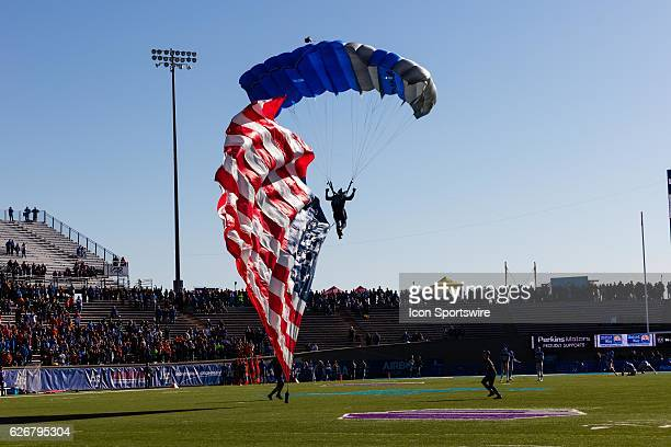 Air Force Academy's Wings in Blue brings in the American flag during Air Force's 2720 upset of ranked on November 25 Boise State at Falcon Stadium in...