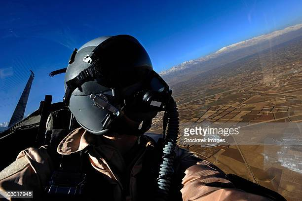 U.S. Air Force Aerial Combat Photographer watches for threats to a F-15E Strike Eagle.