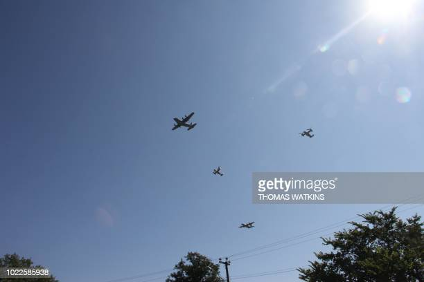 US Air Force aircraft perfom a Missing Man Formation flyover by the Air Force Memorial on August 24 in Arlington Virginia during a ceremony...