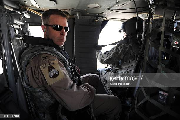 Air Force airman sits aboard a helicopter at the US Embassy helipad in the Green Zone on December 3 2011 in Baghdad Iraq With less than 12000...