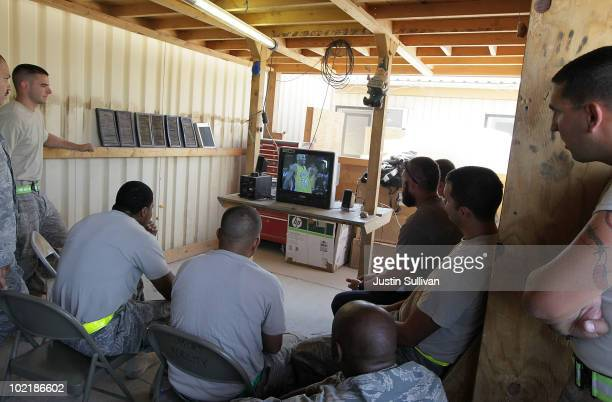 S Air Force Airmen watch game seven of the NBA finals June 18 2010 at Kandahar Air Field in Kandahar Afghanistan The Los Angeles Lakers defeated the...