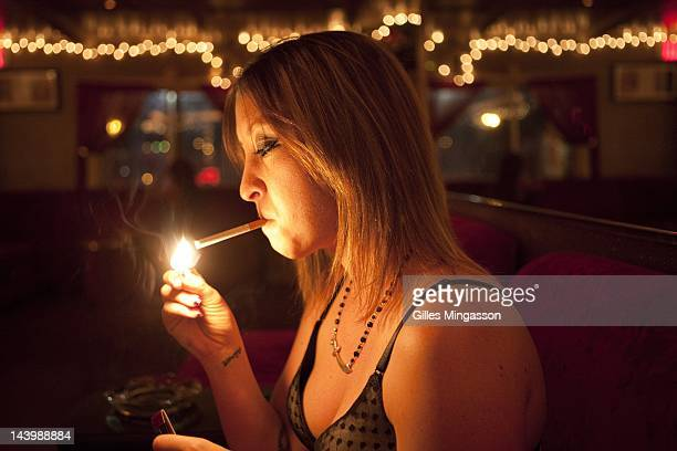 Air Force Amber lights up as she waits for a client on November 18 2010 at the Love Ranch a brothel located on the outskirts of Carson City the state...