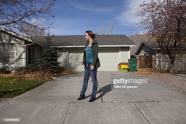 Air Force Amber stands in front of the house of a friend on on November 18 her day off not far from the Love Ranch a brothel located on the outskirts...