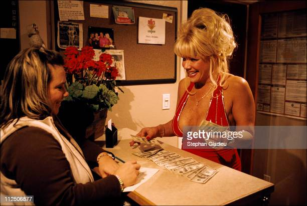 Air Force Amy, a prostitute, counts her earnings with the cashier at the Moonlite Bunny Ranch, a legal brothel owned by Dennis Hof, in Lyon County,...