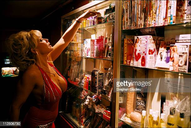 Air Force Amy, a working girl, checks out the 'tools' that are available for sale at the Moonlite Bunny Ranch, a legal brothel owned by Dennis Hof,...
