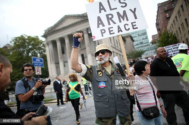 Air Force and Navy veteran Frank Rodriguez marches during a rally against police violence on August 23 2014 in the Staten Island borough of New York...
