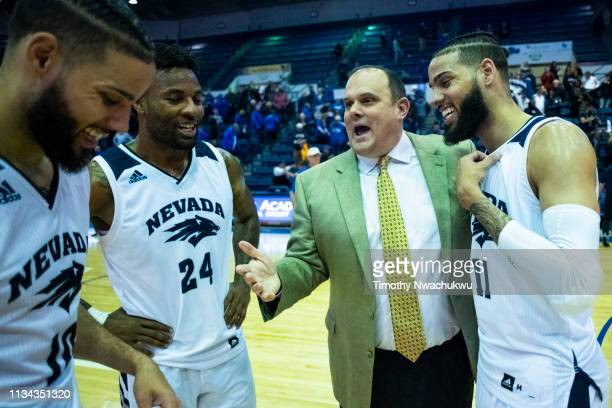 Air Force associate head coach Andrew Moore centerright speaks with Caleb Martin Jordan Caroline and Cody Martin of the Nevada Wolf Pack at Clune...