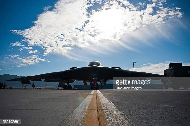 A U.S. Air Force B-2 Spirit is inspected by ground crews.