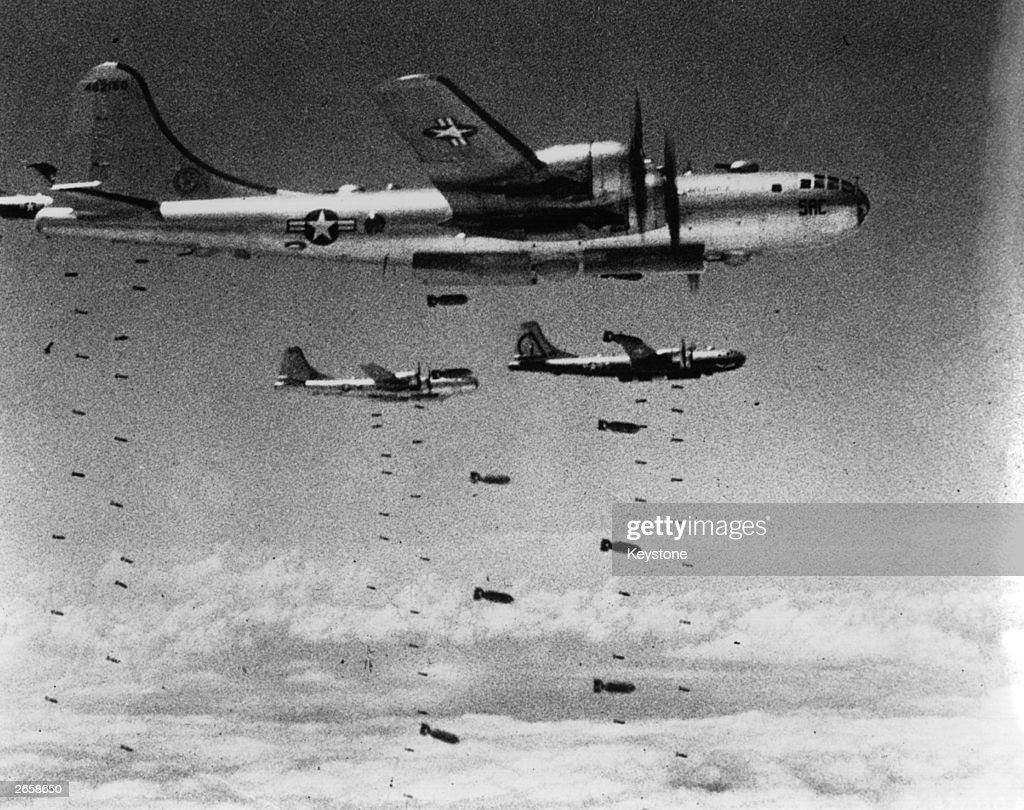 US Air Force B-29 Superfortresses dropping bombs on a strategic target during the Korean War.