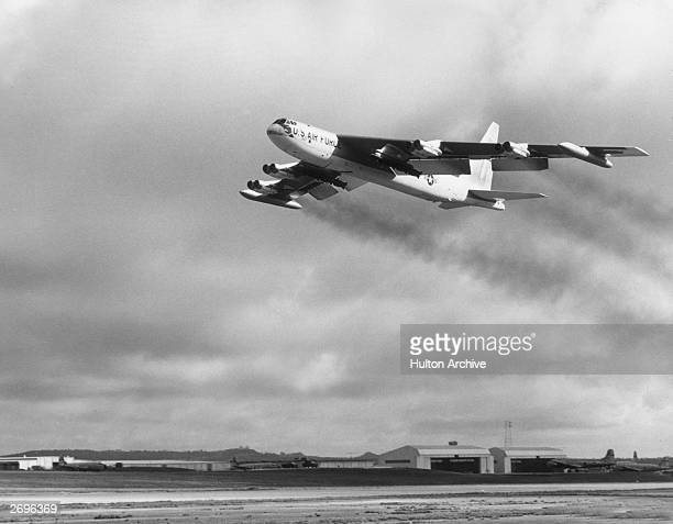 Air Force B52 bomber carrying a dozen 750pound bombs under each wing and 27 bombs inside the aircraft takes off from the US base in Guam to head for...