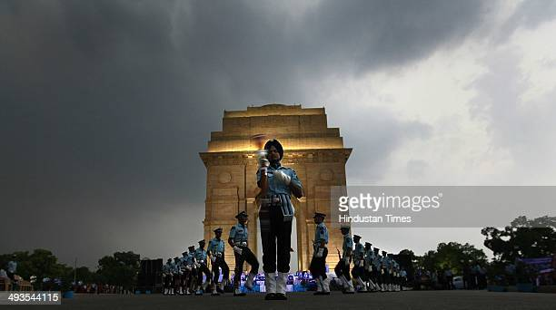 Air force band performing live band and riffles demonstration skills for public at India Gate on May 24 2014 in New Delhi India