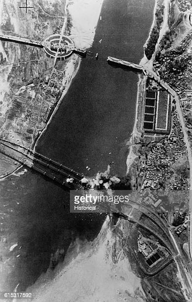 US Air Force bombs explode on the three spans of the Han River bridges They were destroyed to slow the North Korean pursuit of the South Korean and...