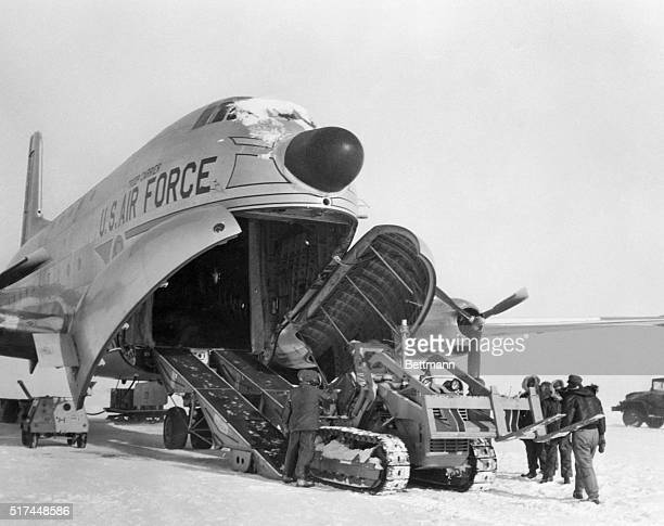 US Air Force C124 transport plane unloads a tractor at the site of the DEW radar line which is being constructed in the Canadian Arctic by the US at...