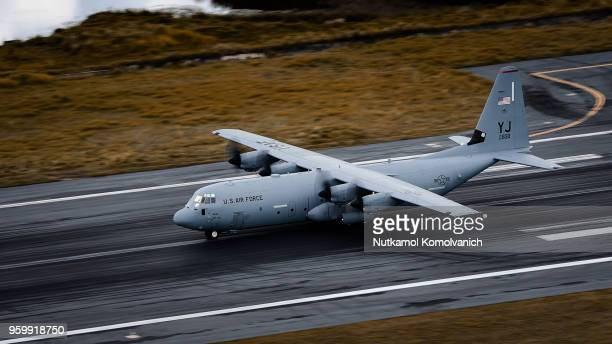 us air force c-130 airplane take off from phuket airport - hercules stock pictures, royalty-free photos & images