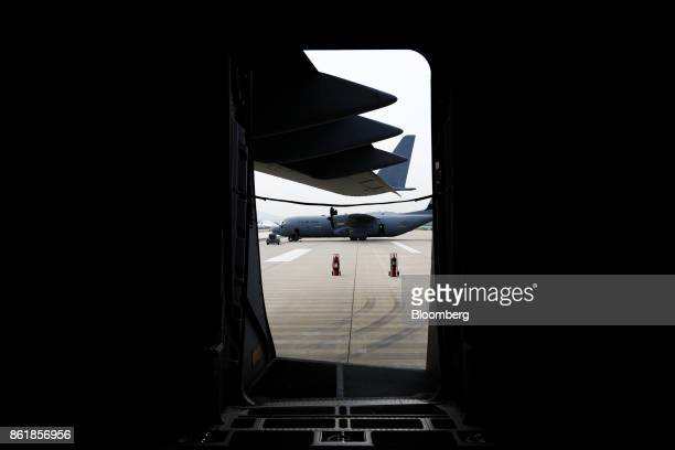 A US Air Force C130J Super Hercules turboprop military transport aircraft manufactured by Lockheed Martin Corp is seen through the doorway of another...