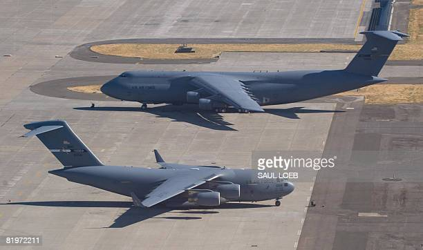 Air Force C5 Galaxy and a C17 Globemaster sit on the tarmac at Travis Air Force Base in Fairfield California on July 17 2008 AFP PHOTO / SAUL LOEB