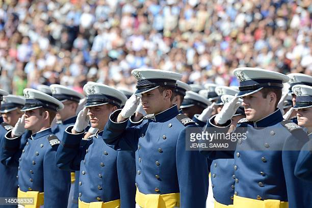 US Air Force cadets salute before US President Barack Obama delivers commencement address at the US Air Force Academy in Colorado Springs Colorado on...