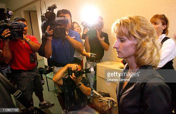 Air Force Capt Colleen Shipman right moves through a crowd of reporters as she arrives at the Orange County courthouse to testify at the hearing for...
