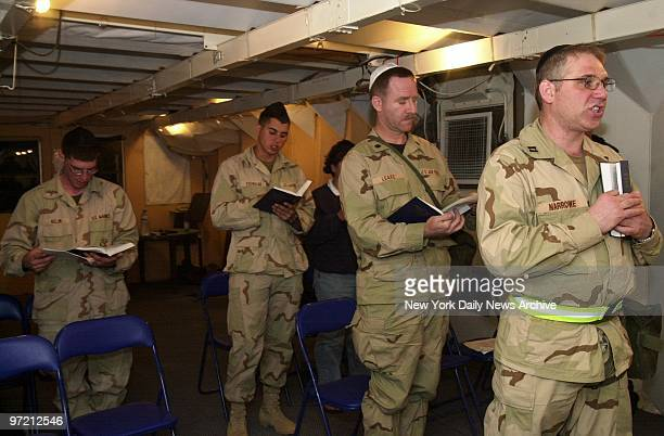 Air Force Capt Joshua Narrowe the Jewish chaplain for the 332nd Air Expeditionary Wing leads Sabbath evening services at Al Jaber Air Base in Kuwait...