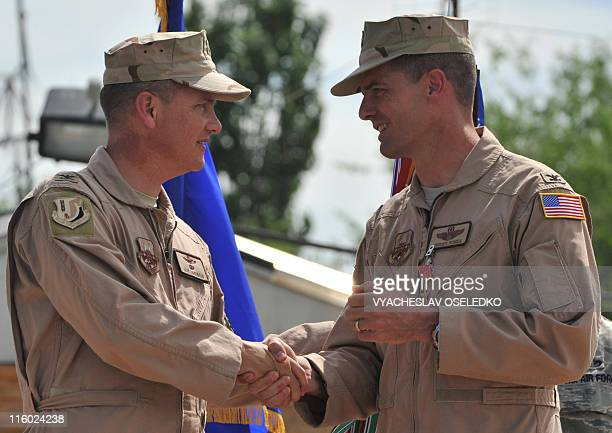 US Air Force Col Dwight Sones relinquishes the command of the 376th Air Expeditionary Wing to Col James Jacobson during the change of command...