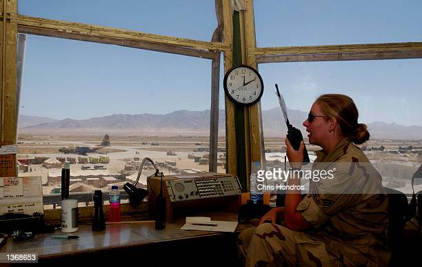 Air Force control tower operater radios as flights take off and land September 5, 2002 at Bagram Air Force Base in Afghanistan. Dozens of flights...