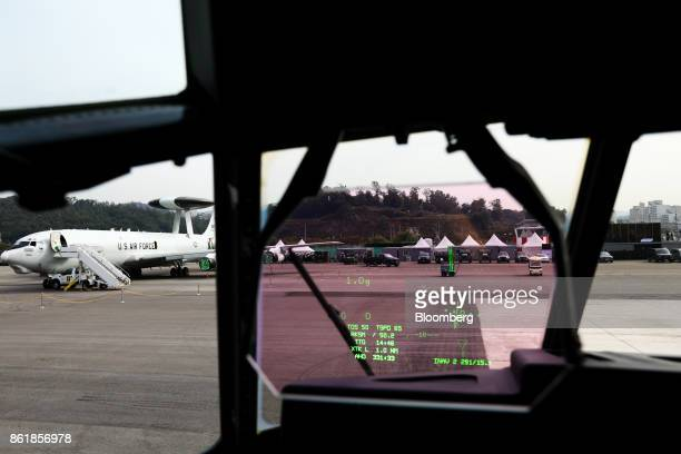 Air Force E3 AWACS aircraft manufactured by Boeing Co sitting on the tarmac is seen through the heads up display of a US Air Force C130J Super...
