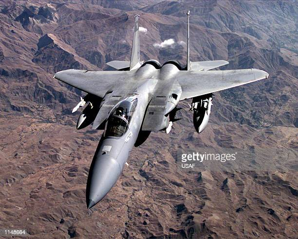 A US Air Force F15C Eagle conducts a routine patrol over Northern Iraq on Dec 30 in support of Operation Northern Watch US and allied air forces...