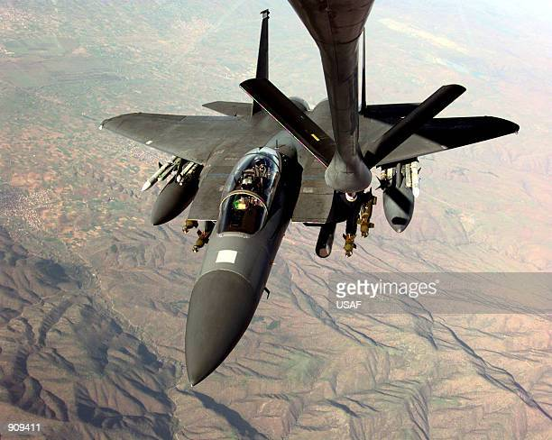Air Force F-15E Strike Eagle refuels in-flight from a KC-135R Stratotanker in the skies over Macedonia on March 26 as the two aircraft fly missions...