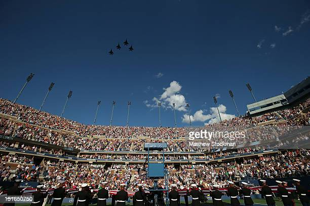 Air Force F15e Strike Eagles fly over Arthur Ashe Stadium as soldiers unfurl the national flag before the start of the women's singles final match...