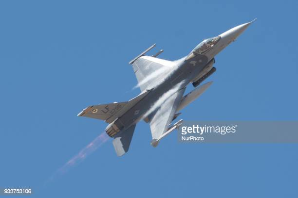 A US Air Force F16 fighter jet flies during a public display at Luke Air Force Base near Phoenix Arizona on Saturday March 17 2018