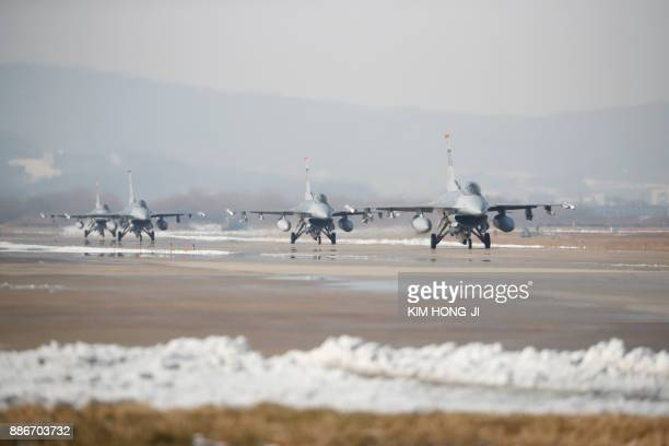 US Air Force F16 fighter jets take part in a joint aerial drills called 'Vigilant Ace' between the US and South Korea at the Osan Air Base in...