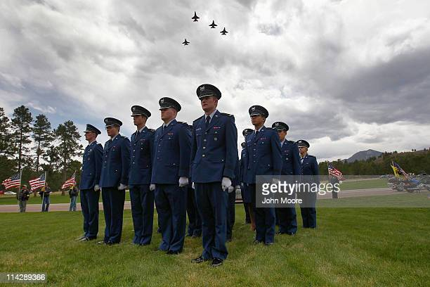 Air Force F16 jets fly over in a missing man formation during a graveside service for Maj David Brodeur at the Air Force Academy on May 17 2011 in...