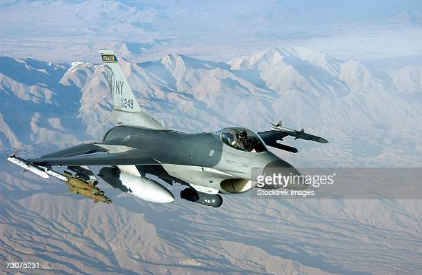 A US Air Force F-16C Fighting Falcon, 174th Fighter Wing (FW), New York Air National Guard (NYANG), Syracuse, New York (NY), in flight over Afghanistan in support of Operation Enduring Freedom.