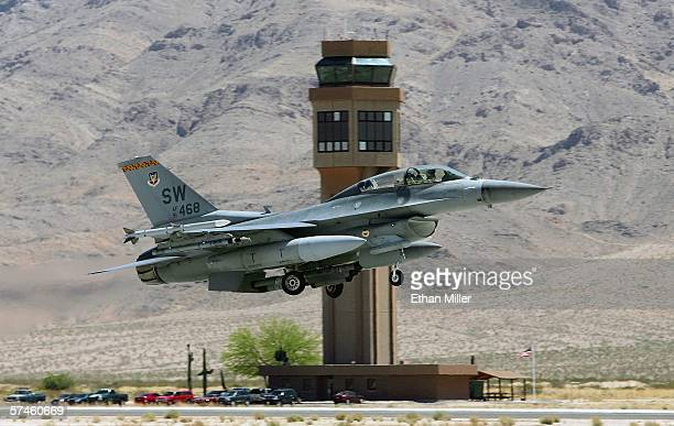 S Air Force F16C Fighting Falcon flies by the Nellis Air Force Base air traffic control tower as it takes off while participating in the Joint...
