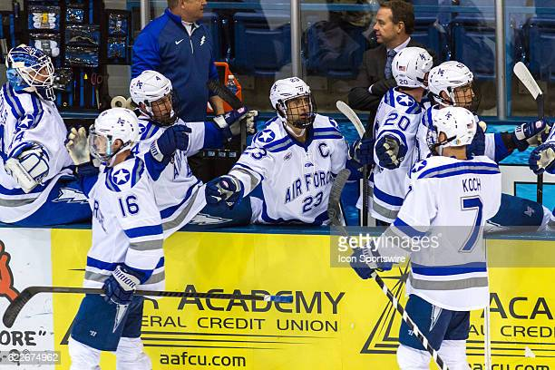 Air Force Falcons celebrate after a second goal during the 1st period of the game between the Air Force Falcons and RIT Tigers at Cadet Ice Arena in...