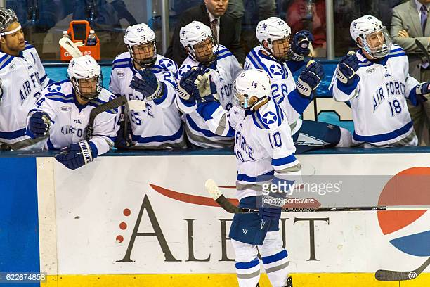 Air Force Falcons forward Jordan Himley celebrates after a goal he made during the 1st period of the game between the Air Force Falcons and RIT...