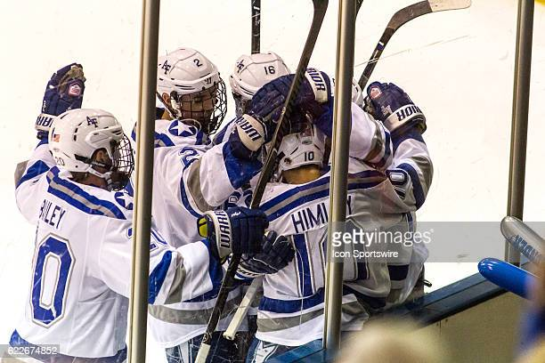 Air Force Falcons forward Jordan Himley makes a goal and celebrates with teammates during the 1st period of the game between the Air Force Falcons...