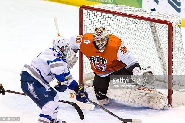 Air Force Falcons forward Jordan Himley takes a shot against RIT Tigers goalie Mike Rotolo during the 1st period of the game between the Air Force...