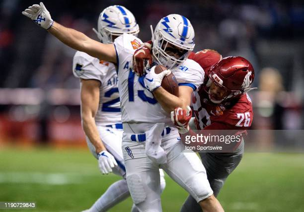 Air Force Falcons running back Nolan Eriksen gets taken down by Washington State Cougars safety Bryce Beekman during the CheezIt Bowl college...