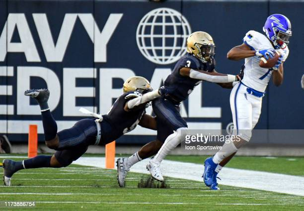 Air Force Falcons wide receiver Geraud Sanders is pushed out of bounds after a reception against Navy Midshipmen cornerback Cameron Kinley on October...