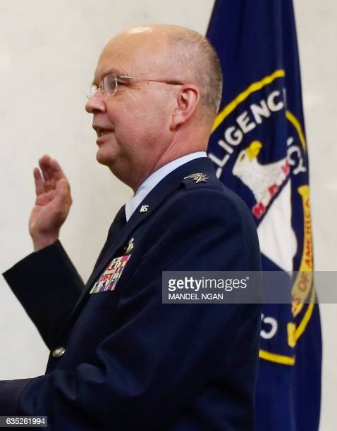 US Air Force General Michael Hayden raises his hand during his ceremonial swearingin as the new director of the Central Intelligence Agency 31 May...