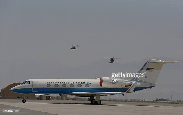 Air Force Gulfstream Aerospace GIV jet airplane is seen parked as two UH 60 Sikorsky Black Hawk helicopters prepare their final approach prior...