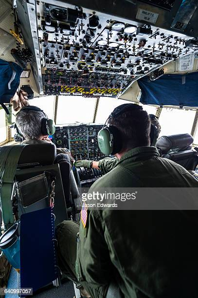 A US air force Hercules flight crew in the cockpit flying to Antarctica.