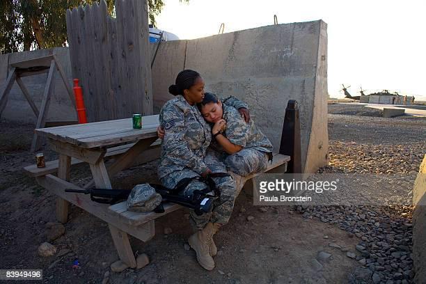 Air Force hospital staff Tawana Jones comforts her friend US Air Force Senior Airman Jeimmy Rivas after she made an error in the emergency room...